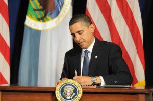 President Barack Obama signs a Memorandum of Understanding